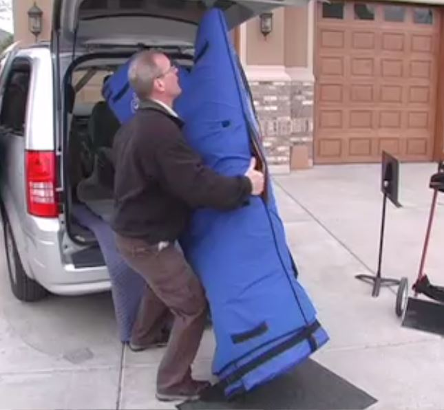 A floor mat or carpet remnant can help protect your harp from pavement during loading.