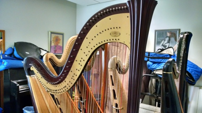 The lighting fixtures in rooms like this crowded harp studio just love to vibrate sympathetically.